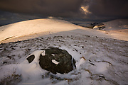 The sun lies, there was NO warmth up here, just a severe and bitterly cold wind blowing from the East over the Carneddau. Slices of sunshine simply skimmed right off the snow surface and was lost in the air. The only compromise was the perfectly rounded and deeply satisfying contour of Moel Wnion in the sunlit distance.