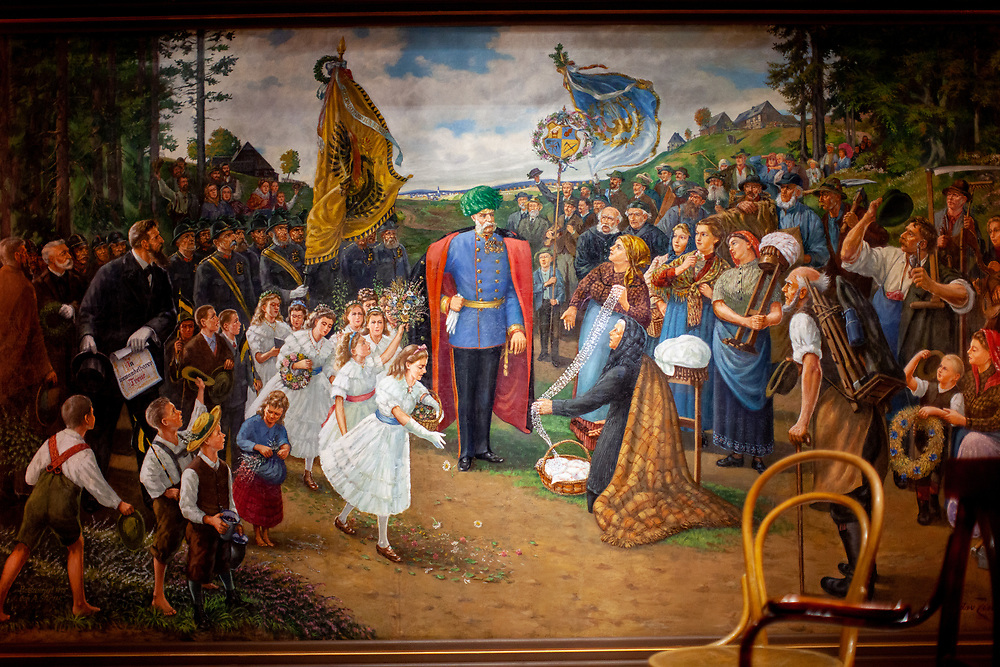 """Exhibition space at The Sudeten German Museum in Munich. Gustav Zindel's picture """"The Ore Mountains Homage to Emperor Franz Joseph I""""."""