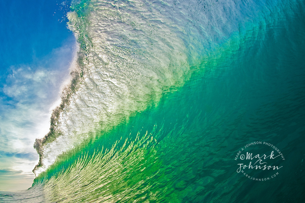 A wall of emerald green water, captured for eternity. As the offshore breeze ruffled the green wave face and the early morning sun backlit the wave, I froze it in mid-air, just for you!