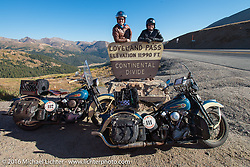 Paul D'Orleans (L) and Matt McManus pose for a photo with Matt's and his Dad Ken's pair of 1936 Harley-Davidson Knucklehead as well as Matt's father Ken's matching 1936 Harley-Davidson Knucklehead that Paul rode this day, here at the top of Loveland Pass during Stage 10 (278 miles) of the Motorcycle Cannonball Cross-Country Endurance Run, which on this day ran from Golden to Grand Junction, CO., USA. Monday, September 15, 2014.  Photography ©2014 Michael Lichter.