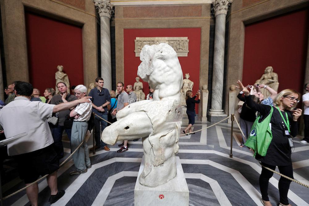 tourist guides at the Belvedere torso Vatican Museum