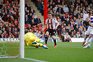 Queens Park Rangers goalkeeper Alex Smithies (1) comes out early to smother the ball during the EFL Sky Bet Championship match between Brentford and Queens Park Rangers at Griffin Park, London, England on 22 April 2017. Photo by Andy Walter.
