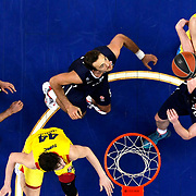 Anadolu Efes's Semih Erden (C) and Dusko Savanovic (R) during their Euroleague Top 16 round 8 basketball match Anadolu Efes between Barcelona at the Abdi Ipekci Arena in Istanbul at Turkey on Thursday, February 27, 2014. Photo by Aykut AKICI/TURKPIX