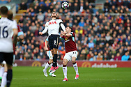 Vincent Janssen of Tottenham Hotspur jumps above Stephen Ward of Burnley to head the ball. Premier League match, Burnley v Tottenham Hotspur at Turf Moor in Burnley , Lancs on Saturday 1st April 2017.<br /> pic by Chris Stading, Andrew Orchard sports photography.