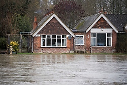 © Licensed to London News Pictures. 03/02/2021. Chertsey, UK. Flood water approaches a property on the banks of The Thames, where the river has broken it's bank. Large parts of the UK experience more wet conditions which is expected to bring further flooding. Photo credit: Ben Cawthra/LNP