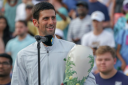 August 19, 2018 - Mason, Ohio, USA - Novak Djokovic (SRB) holds the Rookwood Trophy for winning Sunday's final at the Western and Southern Open at the Lindner Family Tennis Center, Mason, Oh. (Credit Image: © Scott Stuart via ZUMA Wire)