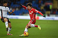 Cardiff's Kim Bo-Kyung ® makes a break. Skybet football league championship match, Cardiff city v Rotherham Utd at the Cardiff city stadium in Cardiff, South Wales on Saturday 6th December 2014<br /> pic by Andrew Orchard, Andrew Orchard sports photography.