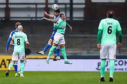 Jack Baldwin of Bristol Rovers is challenged by Luke Charman of Darlington - Rogan/JMP - 30/11/2020 - FOOTBALL - Memorial Stadium - Bristol, England - Bristol Rovers v Darlington - FA Cup Second Round Proper.
