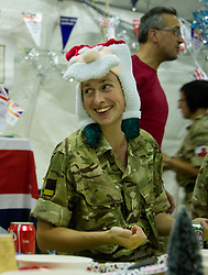 "© licensed to London News Pictures. AFGHANISTAN  25/06/1. Christmas came early for members of the Military Field Hospital at Camp Bastion in Helmand Province today (25th June 2011).  The party was organised to boost morale and celebrate Armed Forces Day..Lieutenant Commander Al Murray - the second-in-command at the hospital - said: ""It's the middle of the year, so we thought 'Why not?'. Sometimes we need to unwind and we come up with these weird and whacky ideas."". Please see special instructions. Photo credit should read Alison Baskerville/LNP"