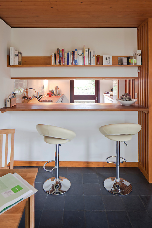 breakfast bar in kitchen diner in modern 1960s designed house