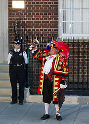 © Licensed to London News Pictures. 22/07/2013. London, UK. Tony Appleton, a town crier announces that the Duchess of Cambridge has given birth to a baby boy, outside the Lindo Wing of St Mary's Hospital in Paddington, London, today (22/07/2013). Photo credit: Matt Cetti-Roberts/LNP