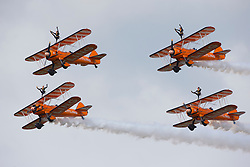 © Licensed to London News Pictures. 12/07/2014. RAF Fairford UK. The Breitling Wingwalkers Perform at the Royal International Air Tattoo at RAF Fairford. Photo Credit : Ian Schofield/LNP