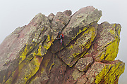 Obadiah Reid climbs to the summit of the First Flatiron (Direct East Face, 5.6) above Boulder, Colorado.