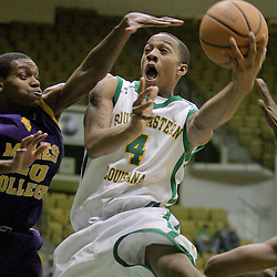 17 November 2008: Lions center Patrick Sullivan (4) puts up a shot between Golden Bears defenders D'Jari Nelson (40) and Quedarius McGhee (21) during the Southeastern Louisiana Lions 95-69 victory over the Miles College Golden Bears at the University Center in Hammond, LA.