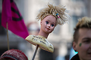 A protestor holds a dolls head during a during a protest against climate change in the middle of Oxford Circus on 15th April, 2019 in London, United Kingdom.  Extinction Rebellion have blocked five central London landmarks in protest against government inaction on climate change. .