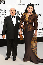 File photo dated 22/5/2008 of Saudi arms dealer Adnan Khashoggi, with wife Lamia, who has died at the age of 82, his family said.