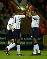 Photograph: Scott Heavey.<br />Norwich City v Tottenham Hotspur. Carrow Road. 22/07/2003.<br />Bobby Zamora celebrates with Gustavo Poyet.