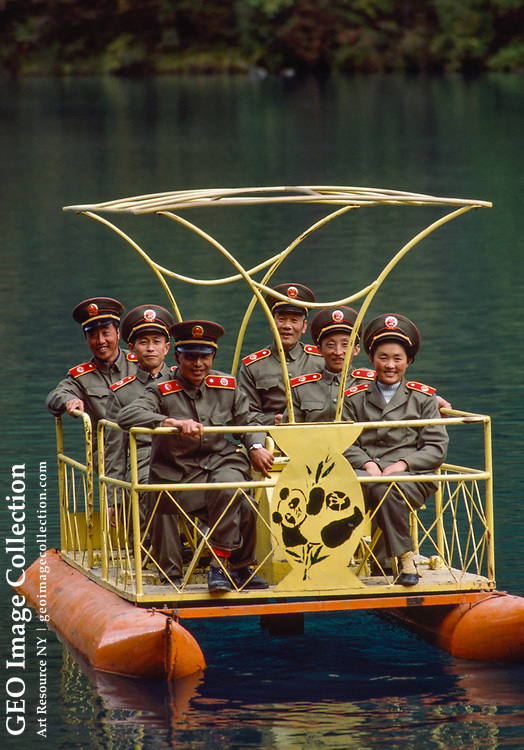 Members of an investigative police force take a boat ride at a resort.