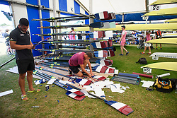 © Licensed to London News Pictures. 04/07/2018. Henley-on-Thames, UK. Oars being prepared on day one of the Henley Royal Regatta, set on the River Thames by the town of Henley-on-Thames in England. Established in 1839, the five day international rowing event, raced over a course of 2,112 meters (1 mile 550 yards), is considered an important part of the English social season. Photo credit: Ben Cawthra/LNP