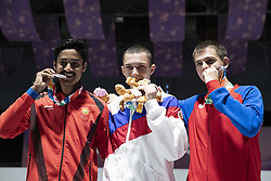 BUENOS AIRES, Oct. 8, 2018  Gold medalist Grigorii Shamakov (C) of Russia, silver medalist Shahu Tushar Mane (L) of India and bronze medalist Aleksa Mitrovic of Serbia pose for photos during the awarding ceremony of the Men's 10m Air Rifle Final at the 2018 Summer Youth Olympic Games in Buenos Aires, capital of Argentina, Oct. 7, 2018. Grigorii Shamakov won the first gold of the games with 249.2 points. (Credit Image: © Li Ming/Xinhua via ZUMA Wire)