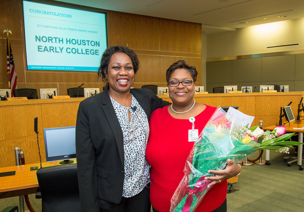 Esther Omogbehin, left, recognizes Angela Lundy-Jackson for North Houston Early College's Blue Ribbon School award during the Professional Learning Series, October 3, 2015.