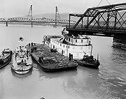 Y-480215.  The second Morrison Bridge, built in 1905, was a swing bridge that opened by rotating on a central pinion. On February 15, 1948, the sternwheeler Jean, a Willamette River paddlewheel steamboat, was moving down the river through the Morrison Bridge. Before the Jean could clear the bridge it swung to close and knocked the wheel house off the boat. The bridge was replaced with the present Morrison bridge in 1958.