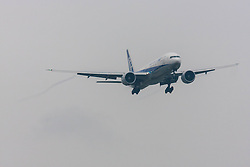 London Heathrow Airport, November 16th 2014. An ANA Boeing 777-300 trails wake vortices as it prepares to land on runway 09L at London Heathrow.