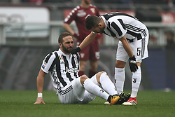 February 18, 2018 - Turin, Italy - Juventus forward Gonzalo Higuain (9) lies on the pitch injured during the Serie A football match n.25 TORINO - JUVENTUS on 18/02/2018 at the Stadio Olimpico Grande Torino in Turin, Italy. (Credit Image: © Matteo Bottanelli/NurPhoto via ZUMA Press)