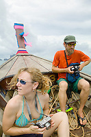 Couple riding in longtail boat Andaman Sea Thailand&#xA;<br />