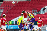 Bristol City's Famara Diédhiou (9) beats Exeter City's Rory McArdle (6) during the EFL Cup match between Bristol City and Exeter City at Ashton Gate, Bristol, England on 5 September 2020.