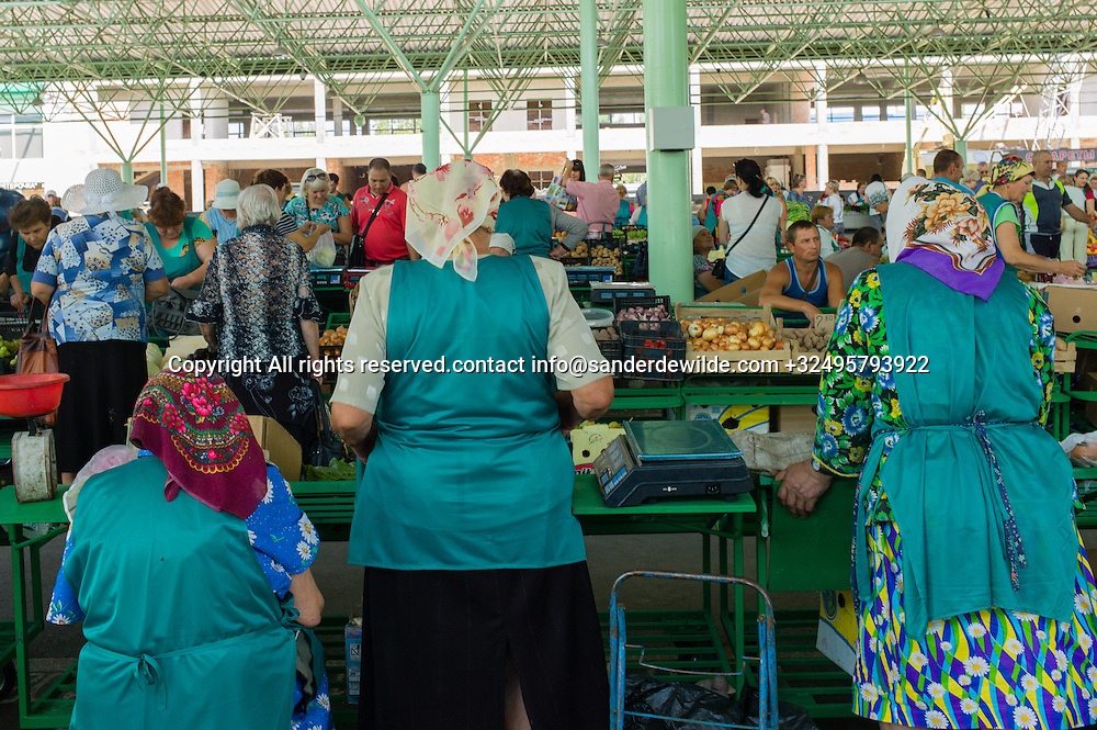 20150826 Tiraspol, Transnistria,   Moldova.  The Zeleny Market (central market)in Tiraspol is piled up with farming<br /> products. This area is renewed and it is now called Green market, and women have to wear green .
