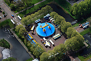 Nederland, Zuid-Holland, Leidschendam, 09-05-2013; Circus met circustent., midden in woonwijk. De Heuvel, nieuwbouwwijk uit de jaren zestig, overloopgebied voor Den Haag. <br /> Basiontwerp is rechthoekig hof bestaande uit dubbele ring van woningen (middelhoogbouw) met daarbinnen voorzieningen in het groen. Wederopbouwgebied.<br /> New residential area built in the sixties, overflow area for The Hague. Basic design is rectangular court with a double ring of housing (medium-rise) and green courtyard in the middle. Reconstruction area.<br /> luchtfoto (toeslag op standard tarieven)<br /> aerial photo (additional fee required)<br /> copyright foto/photo Siebe Swart