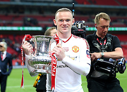 Wayne Rooney of Manchester United poses with the FA Cup Trophy - Mandatory by-line: Robbie Stephenson/JMP - 21/05/2016 - FOOTBALL - Wembley Stadium - London, England - Crystal Palace v Manchester United - The Emirates FA Cup Final