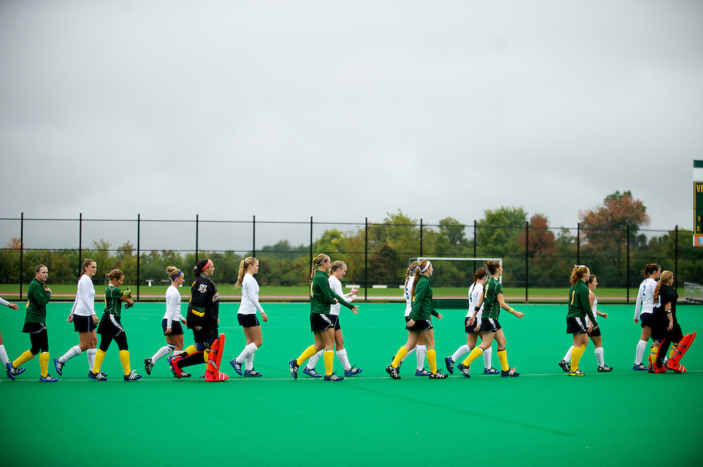 Both teams make there way to the center of the field for player introductions and the National Anthem before the start of the women's field hockey game between the Maine Black Bears and the Vermont Catamounts at Moulton/Winder Field on Saturday afternoon September 29, 2012 in Burlington, Vermont.