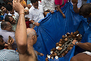 Smashing coconuts for blessing as Hindu devotees participate in the annual Tamil chariot festival at the Murugan Temple in Highgate, London, England 17th July 2016. Thousands attend the colourful celebration as the temple's Goddess Amman (Tamil for Mother) is paraded on a beautifully decorated chariot pulled by the people through the streets around the temple, which brings to a close the four week Mahotsava festival.