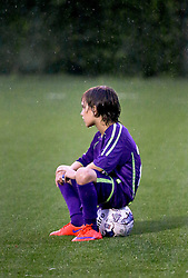 24 June 2015. New Orleans, Louisiana.<br /> National Premier Soccer League. NPSL. <br /> Jesters 0 - Atlanta Silverbacks 1.<br /> A New Orleans Jesters junior academy player gets soaked in the rain at home in the Pan American Stadium. <br /> Photo©; Charlie Varley/varleypix.com