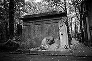 Grieving sculpture at Powązki Cemetery (Cmentarz Powązkowski), one of the oldest cemeteries in Warsaw, Poland. It was established in 1790.