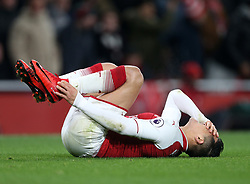 02 December 2017 London : Premier League Football : Arsenal v Manchester United - Alexis Sanchez of Arsenal holds his injured ankle.<br /> (photo by Mark Leech)