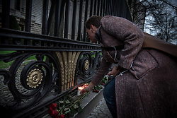 April 3, 2017 - Berlin, Berlin, Germany - A woman lights a candle at the Russian Embassy in Berlin,  Monday, April 3, 2017, in memory of the St. Petersburg metro blast victims..A bomb blast tore through a subway train deep under Russia's second-largest city Monday, killing several people and wounding many more in a chaotic scene that left victims sprawled on a smoky platform. (Credit Image: © Zacharie Scheurer/NurPhoto via ZUMA Press)