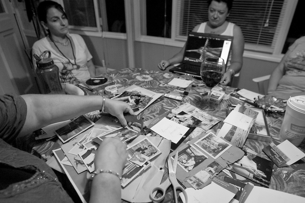 Sept. 14, 2009 - Marie's daughter Marcie Keller, bottom left, sorts through photos of her deceased mother as she, close family friend Cheryl Guertin, and Marie's other daughter Tracie Marcil prepare for Marie's memorial service as they listen to a CD of an interview that Marie had recorded through her hospice care.