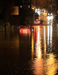 ©Paul Thompson Licensed to London News Pictures. 12/12/2015. Clayton, near Bradford, West Yorkshire. A car stranded in flood water after torrential rain. Photo credit :Paul Thompson/LNP