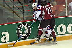 Tom Gilbert (77) and Armands Berzins (21) at ice-hockey match USA vs Latvia at IIHF WC 2008 in Halifax,  on May 02, 2008 in Metro Center, Halifax, Canada.  (Photo by Vid Ponikvar / Sportal Images)