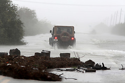 October 8, 2016 - St. Augustine, Florida, U.S. - DOUGLAS R. CLIFFORD   |   Times.A Jeep is used to navigate flooded state road 206 which connects Crescent Beach to the mainland south of St. Augustine. The flooding was the result of hurricane Matthew passing to the east on Florida's east coast. (Credit Image: © Douglas R. Clifford/Tampa Bay Times via ZUMA Wire)