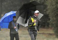 Golf - 2018 Sky Sports British Masters - Sunday, Fourth Round<br /> <br /> Alexander Bjork of Sweden under the umbrella, at Walton Heath Golf Club.<br /> <br /> COLORSPORT/ANDREW COWIE