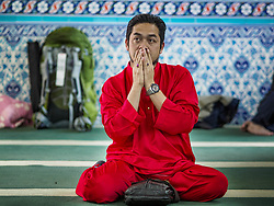 June 15, 2018 - Seoul, Gyeonggi, South Korea - A man prays in Seoul Central Mosque on Eid al Fitr, the Muslim Holy Day that marks the end of the Holy Month of Ramadan. There are fewer than 100,000 Korean Muslims, but there is a large community of Muslim immigrants in South Korea, most in Seoul. Thousands of people attend Eid services at Seoul Central Mosque, the largest mosque in South Korea. (Credit Image: © Jack Kurtz via ZUMA Wire)