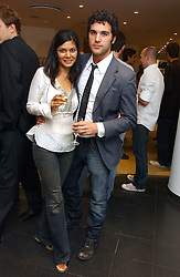 Actor JUAN PABLO DI PACE and actress MENEKA DAS at an exhibition of photographs entitled 'Hispanic in Hollywood' at Jaeger's Flagship store 200 Regent Street, London on 30th August 2006.<br /><br />NON EXCLUSIVE - WORLD RIGHTS