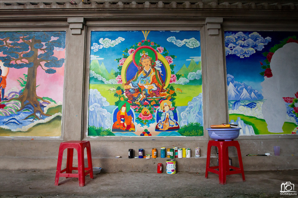 The walls of the Thang Nghiem Temple in Hanoi, Vietnam, are decorated with Buddhist paintings.  Pagodas act as social work agencies providing support to local communities.  Photo by Stan Olszewski/SOSKIphoto