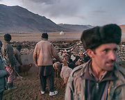 """Sheep and goat herd returns. Life in Baiqara, a Wakhi High pasture inhabited for about 6 months of the year, from May until October. Guiding and photographing Paul Salopek while trekking with 2 donkeys across the """"Roof of the World"""", through the Afghan Pamir and Hindukush mountains, into Pakistan and the Karakoram mountains of the Greater Western Himalaya."""
