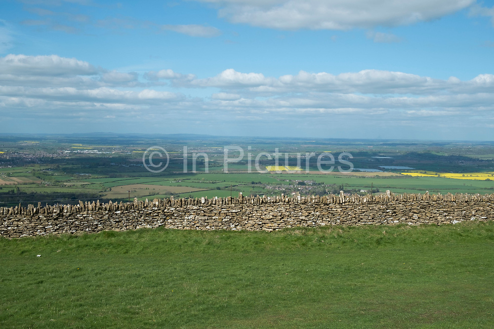 Spring dry stone wall view in countryside near Great Comberton at Bredon Hill in Worcestershire, England, United Kingdom.