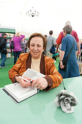 © Licensed to London News Pictures. 28/05/2016. Hay-on-Wye, Powys, Wales, UK. Iranian human rights lawyer and activist signs books at The  2016 Hay Festival. Fine weather on the third day of the Hay Festival at Hay-on-Wye, Wales. Photo credit: Graham M. Lawrence/LNP